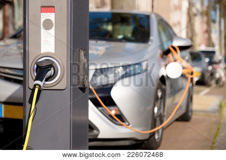 Charging Silver Electric Car .