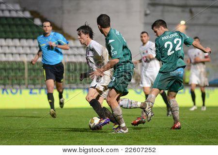 KAPOSVAR, HUNGARY - JULY 30: Bojan Pavlovic (in green 22) in action at a Hungarian National Championship soccer game - Kaposvar (green) vs Videoton (white) on July 30, 2011 in Kaposvar, Hungary.