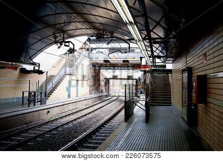 Subway station with empty platform outdoors in Barcelona, Spain