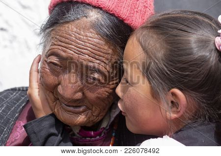 Tibetan Buddhist Old Women And Child During Hemis Festival In Ladakh, North India