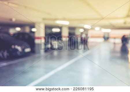 Blurred Image/ Parking Garage - Interior Shot Of Multi-story Car Park, Underground Parking With Cars