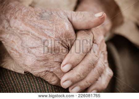 Hands Asian Elderly Woman Grasps Her Hand On Lap, Pair Of Elderly Wrinkled Hands In Prayer And Trace