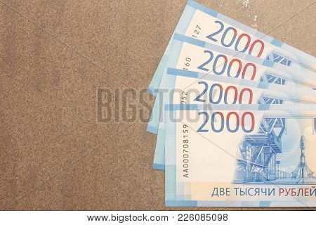 New Russian Banknotes Denominated In 2000 Rubles On A Gray Background With Copy Space
