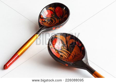 Wooden Spoons Decorated In Hohloma Style. Russian Spoons.