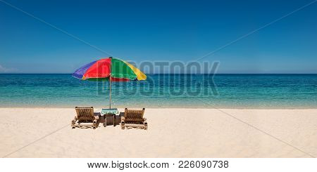Panorama Of Colorful Umbrella With Beach Chairs On The White Sand Beach With Blue Sky,copyspace