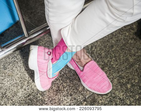 Sore Ankle,  Tourist Used Ankle Bandage Keep Her Ankle When Walking For A Long Time