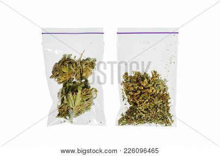 Two Bags Of Different Marijuana On A White Background. High Resolution Photo.