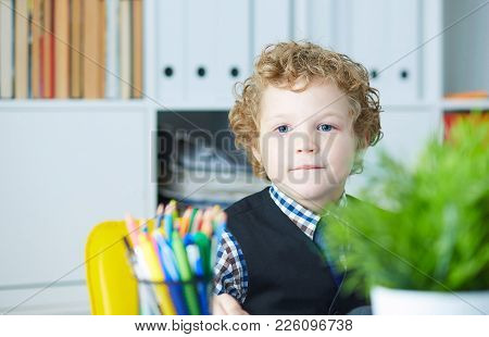 Young Business Boy. Funny Child Looks Like A Boss On A Subordinate. Little Boss In Office