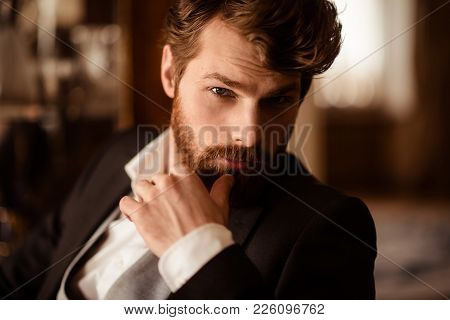Close Up Portrait Of Confident Businessman Has Thick Ginger Beard And Mustache, Dressed Formally, Be