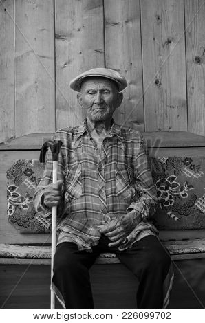 Elder With A Cane. Black And White Photograph
