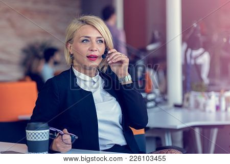 Smiling Agent Woman With Headsets. Portrait Of Call Center Worker At Office