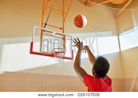 Rear View Of Professional African-american Basketball Player Throwing Ball In Basket While Training