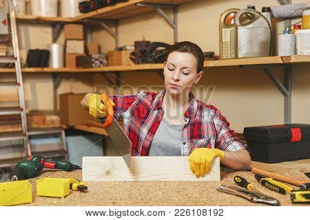Beautiful Smiling Caucasian Young Brown-hair Woman In Plaid Shirt, Gray T-shirt, Yellow Gloves Sawin