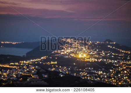 Suntorini After Sunset View With The Lights On. Thira City, Oia, Cyclades, Greece