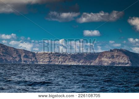 Sea View Of Volcanic Island Of Santorini With White Villages On Top Of Cliffs, Greece