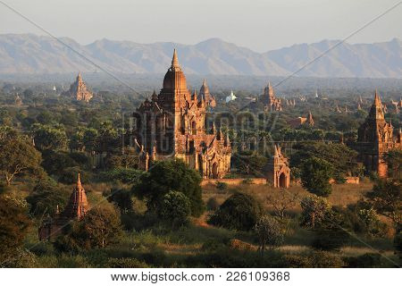 Group Of Ancient Pagodas At The Scenic Sunrise At  Myanmar. Landscape Of Many Ancient Buddhist Templ