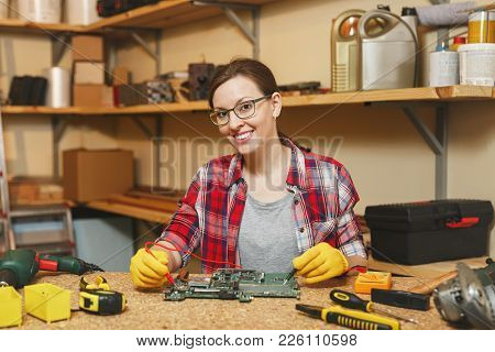 Multimeter For Electrician. Pretty Young Woman In Yellow Gloves, Glasses Digital Electronic Engineer
