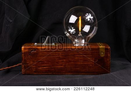 Light Fixture Handmade In Vintage Style, Wooden Case, Copper Finish, Led Lamp On A Black Background.