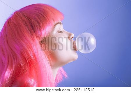 Girl In A Wig Inflates A Bubble From Chewing Gum