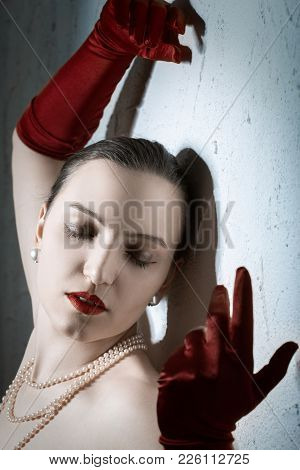 Beauty Fashion Glamorous Model Female Portrait. Vintage Style Mysterious Woman Wearing Red Glamour G