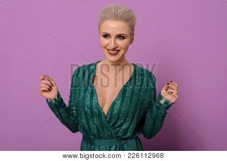 Happy Close-up Portraits Of Young Attractive Woman In An Emerald Evening Gown