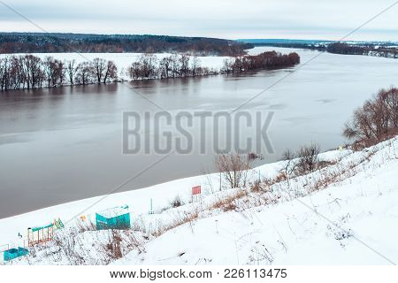 Birch Winter River In The City. Beautiful River Landscape In Winter. Snowy Hills, And The River Goin