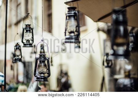 Wedding Ceremony With A Lot Of Lit Hurricane Lamps