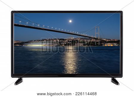 A High-definition Television With  Night City And A Bridge Illuminated By Flashlights On The Screen