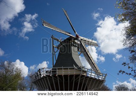 Ancient Dutch Windmill With A Blue Sky Background In Lisse, Netherlands, Europe