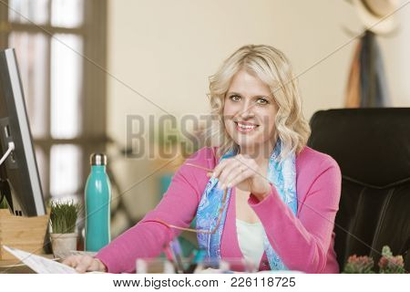 Pretty Professional Woman In Her Modern Office