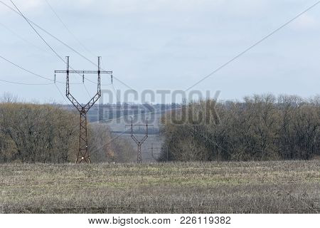 Parallel Rows Of The Power Tower (transmission Towers, Electricity Pylon, Steel Trellis Tower) Throu