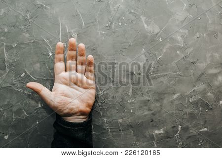 Palmistry Concept. Male Hand On Gray Table With Open Palm, Top View, Chiromancy Lines Of Fortune, Co