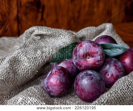 Plum. Fresh Plum. Harvest. Autumn Harvest. Autumn. Blue Plums. Yellow Plum. Fresh Plums On A Wooden