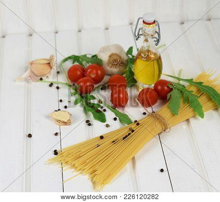 Italian Food Cooking Pasta Ingredients. Food Ingredients For Italian Pasta On White Wooden Backgroun