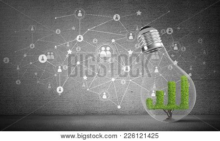 Lightbulb With Green Growing Graph Inside Placed Against Sketched Social Network System On Grey Wall