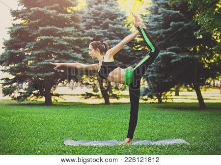 Fitness, Woman Training Yoga In Std Bow Pose Outdoors In The Park, Copy Space. Young Slim Girl Makes