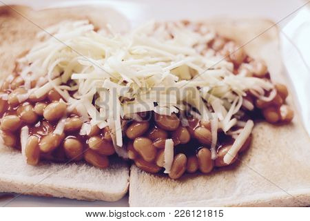 Baked Beans On White Toast Topped With Grated Cheddar Cheese - Filter Applied