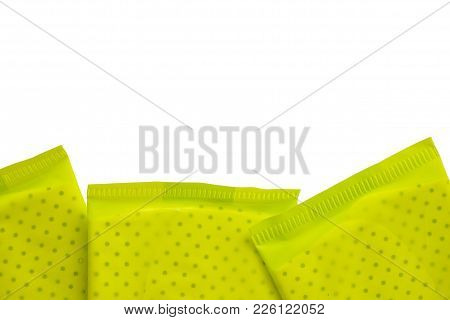Green Package Of Feminine Sanitary Napkin, An Absorbent Item Worn By A Woman While Menstruating, On
