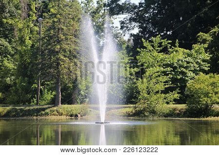Simple Little Fountain In Clarksville, Indiana On A Sunny Summer Day.