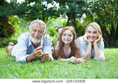 Happy Old Grandparents Having Fun With Grandchildren In Park