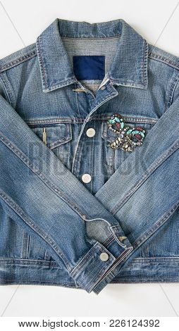 Jeans Denim Woman Jacket With Vintage Brooch On White Background. Fashion Outfit.