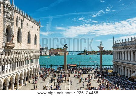 Tourists Walk Across The San Marco Square In Venice, Italy