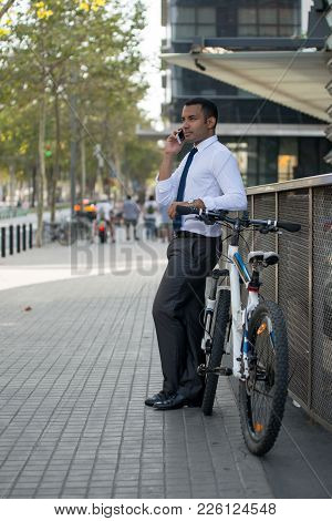 Confident Businessman Leading Active Life With Bicycle. Serious Successful Male Manager Leaning On R