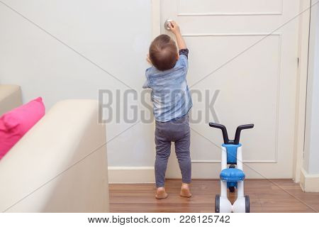 Asian 18 Months / 1 Year Old Toddler Baby Boy Standing On Tiptoes At Home, Kid Reaching Up Try To Op