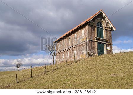 Warehouse On The Dike Along The River Waal Near The Dutch Village Druten