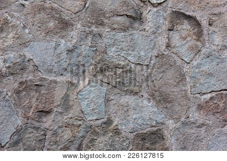 Wall Of Robust And Large Rocks With Cement