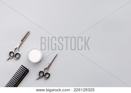 Professional Hairdressing Tools In Beauty Saloon. Combs, Sciccors On Grey Background Top View.