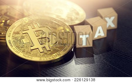 Bitcoin Laying On The Desk Next To Small Wooden Blocks With Tax Letters. Bitcoin And Taxes Concept.