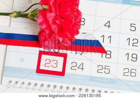 23 February, Defender Of The Fatherland Day, Holiday Card. Red Carnation, Russian Flag And Calendar