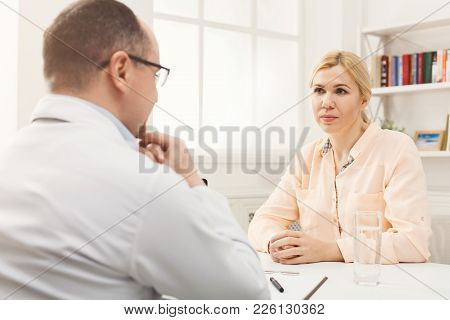 Serious Doctor Consulting Woman At His Office, Healthcare And Medical Concept, Copy Space